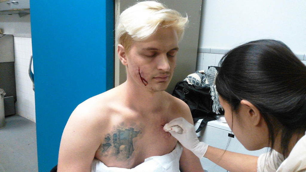Putting a special make up on an actor.